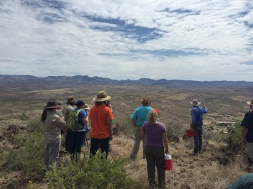 Dr. Hard discussing the site and the floodplain below to the crew (Shown in picture: Gabriella Zaragosa, Rosa Molina, Stephanie Dooley, Robert Gardner, Ian Bates, Kimberly Martin, Haley Fishbeck, Overton Lesley, Megan Brown, Dr. Robert Hard, and David Barron)