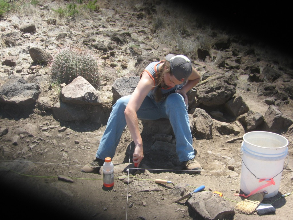 Here I am hard at work on excavating the Southeast Quadrant unit, level 3 of Feature E